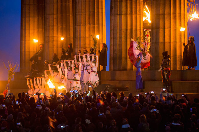 Revellers and performers at the Beltane Fire Festival on Calton Hill, Edinburgh
