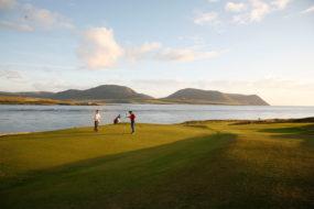 Golfers by the sea at Shetland Golf Club